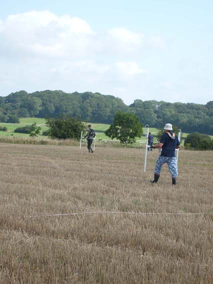 Two gradiometer teams working in the field containing Dampney Barrow.